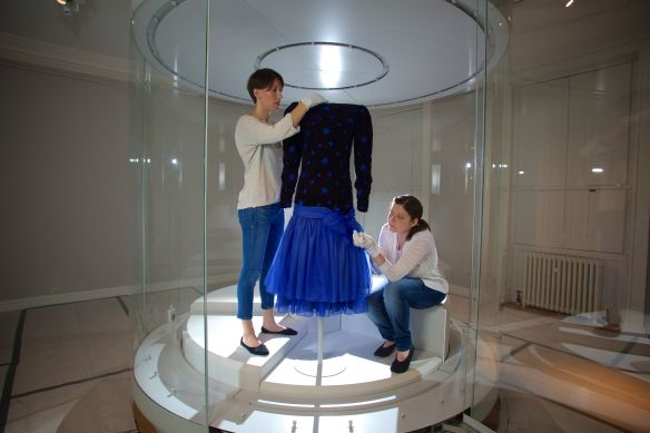 Conservators put the finishing touches to a Dance dress by Jacques Azagury 1985 as worn by Diana, Princess of Wales.